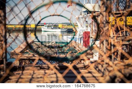 View of a fishing boat thru a lobster trap