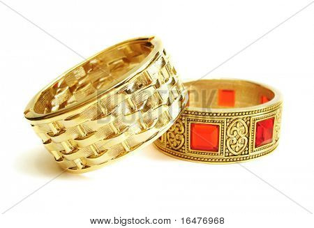Close-up of golden bracelets isolated on white background
