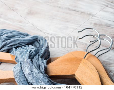 Wooden clothes hangers on bright background. What nothing to wear concept. Woman clothing