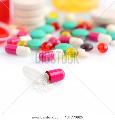 Colored Pills, Capsules And Vitamins Isolated On A White Background
