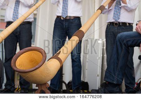 Alphorn or alpenhorn a wooden swiss traditional music instrument