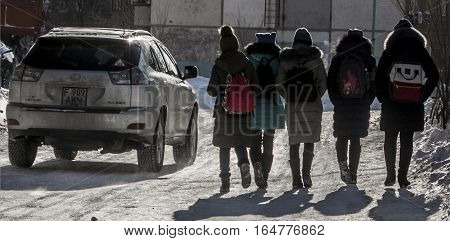Kazakhstan, Ust-Kamenogorsk, 9 january, 2017: Children return home from school, school group. Lexus RX 330