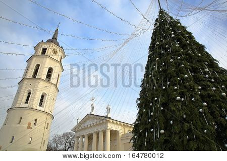 VILNIUS, LITHUANIA: The Belfry (Cathedral Clock Tower) and a Christmas tree  on Cathedral Square with the Cathedral in the background