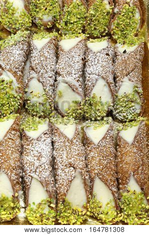 Background Of Delicious Sicilian Cannoli With Grated Pistachios