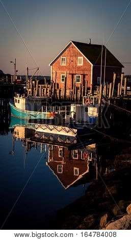 Reflection of a boat in a harbor in Nova Scotia