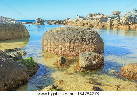 The beautiful and hidden Oudekraal Beach with its calm, turquoise waters, white sand and large boulders, part of Table Mountain area in Cape Town. This area is popular for diving because marine life.