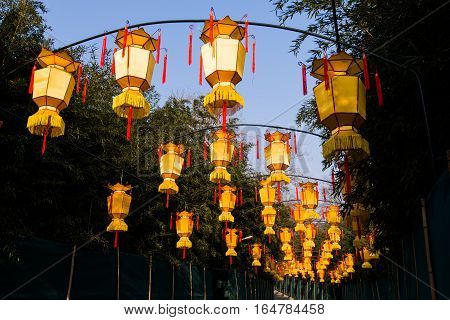Yellow chinese lantern with messages wishing good luck, good health, peace and prosperity