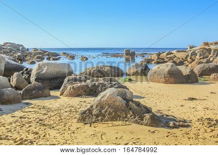 Oudekraal Beach with its calm, turquoise waters, white sand and large boulders, part of Table Mountain area in Cape Town, South Africa. This area is popular for diving because rich marine life.