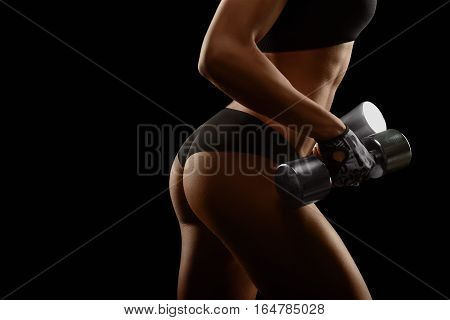 Today is your chance. Closeup shot of perfectly shaped fit and toned female buttocks of an athletic woman with dumbbells in her hands