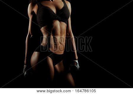 Sweaty workout. Cropped studio shot of a gorgeous female fitness model with fit and toned torso wet after training copyspace on the side