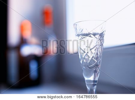 Gass of alcohol on windows desk background hd