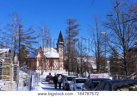 SLOVAKIA STARY SMOKOVEC - JANUARY 06 2015: Church of the Immaculate Conception. Is built in the alpine half-timbered neo-gothic style. The church was designed by the Gideon Majunke in 1888.