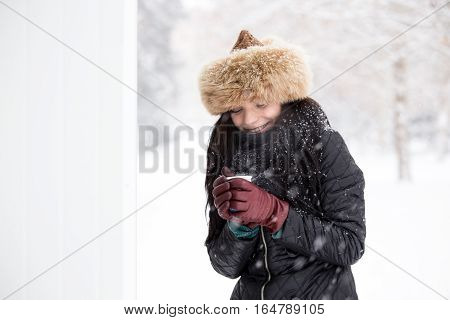 Gorgeous Winter Woman Drinking Hot Drink