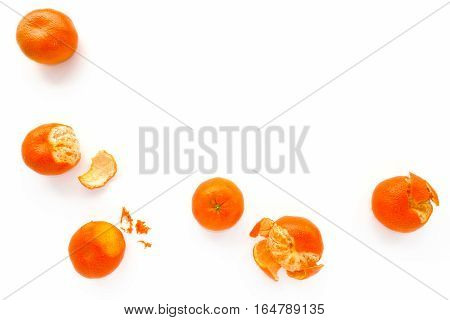 Closeup of Nadorcott Clementines on white as food background with lots of copy space.