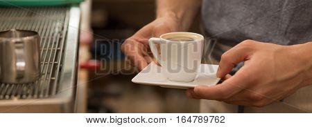 Bartender Holding Cup Of Espresso