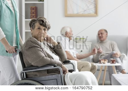 Upset Woman On Wheelchair