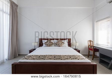 double bed in bedroom at home or motel hotel.