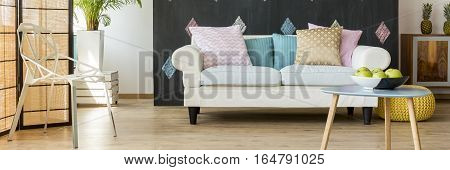 Room With Sofa Full Of Cushions