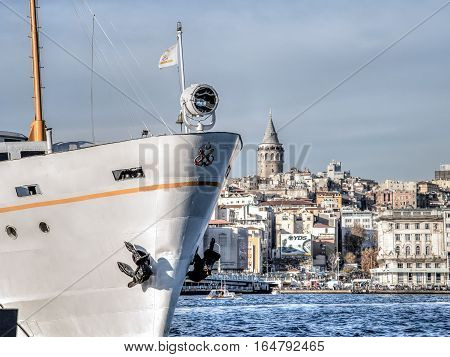 Istanbul, Turkey - November 30, 2013: Istanbul's two icons, the Galata Tower and a passanger ferry