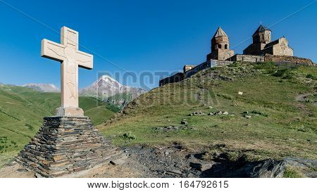 Gergeti, Georgia - August 5, 2015: The cross of the Gergeti Trinity Church