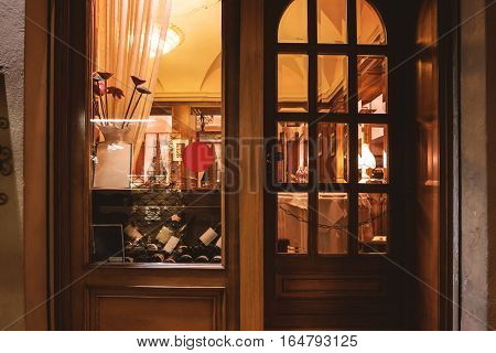 Window of wine shop. Wooden door and storefront. Buy expensive alcohol.