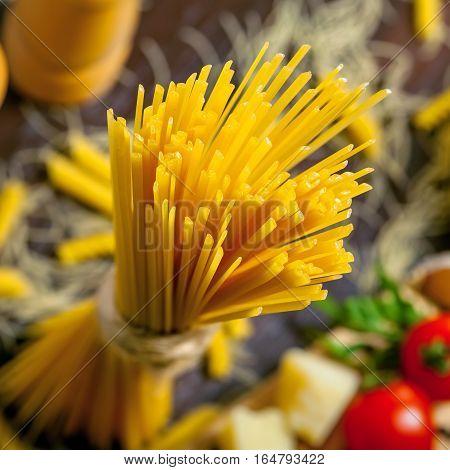 Raw pasta spaghetti close-up shot. Traditional Italian food ingredients.