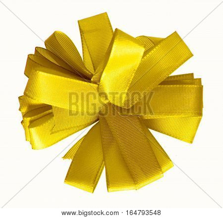 Yellow ribbon bow in the shape of cornflower isolated on white background