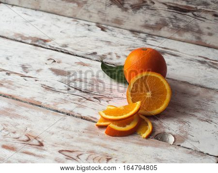Fresh ripe oranges on wooden table. Top view with copy space.