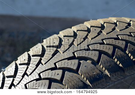 winter car tire closeup in the right side of the frame