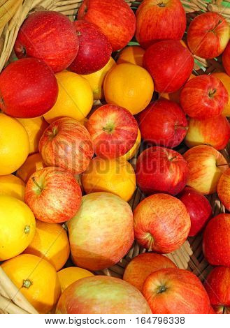 Background Of Ripe Apples And Oranges