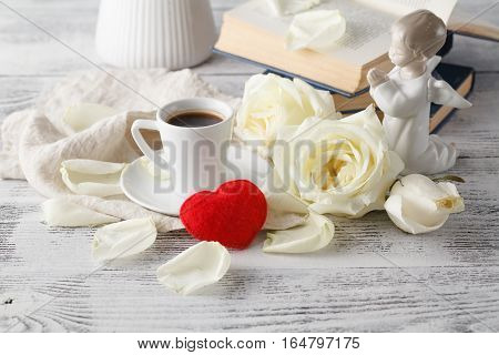 Romantic breakfast coffee with white rose on table
