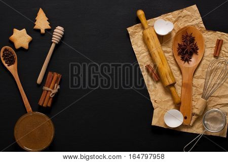 Baking Background With Kitchen Tools And Cookies On Dark Wood