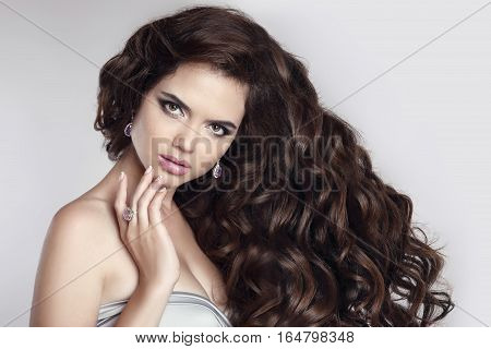 Hair. Beautiful Brunette Woman Portrait.  Attractive Model With Makeup, Fashion Jewelry Set. Young F