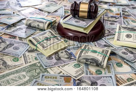Wooden law gavel on us dollar money background