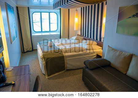 ROTTERDAM THE NETHERLANDS - NOV 24 2016: Cabin with ocean view on the AIDAprima cruise ship