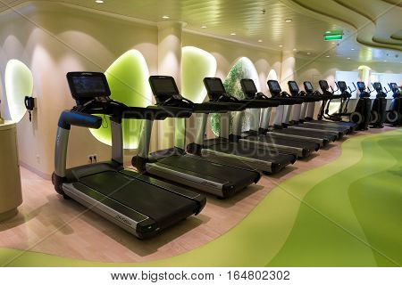 ROTTERDAM - NOV 24 2016: Row of treadmills in the fitness center on board of the AIDAprima cruise ship.