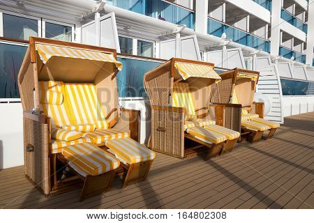 Beach chairs on deck of a cruise ship.