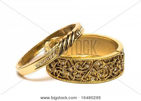 golden bracelets isolated on white background