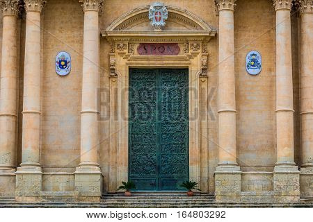 Close up on door of Saint Nicholas of Myra Cathedral in Noto city Sicily in Italy