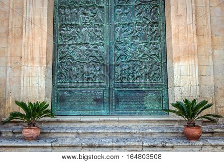 Details of carved door of Saint Nicholas of Myra Cathedral in Noto city Sicily in Italy