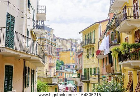 Manarola town Riomaggiore La Spezia province Liguria northern Italy. View of the colourful houses on surrounding hills balconies and windows. Part of the Cinque Terre National Park and a UNESCO World Heritage Site.
