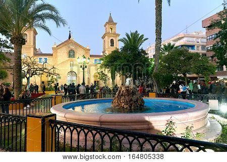 Torrevieja Spain - January 5 2017: Crowd of people in the Constitution square during Cavalcade of the Magi parade. It is one of the most popular squares in the Torrevieja city near it is the Church of the Immaculate Conception