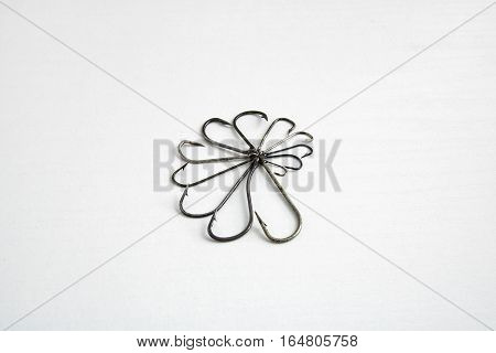Set Of Metallic Gear Fishing Hooks On A White Background
