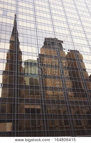 Cathedral of St. Patrick and buidlings behind it reflects in a building next to it 5th Avenue Manhattan NY