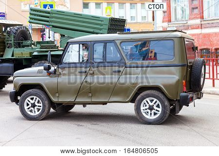 SAMARA RUSSIA - MAY 9 2016: Special russian armored vehicle UAZ-3152 Hussar parked at the city street during the parade on Victory Day