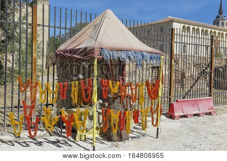 outdoor exhibition of wool skeins dyed with different colors at a free event held in alcala de henares spain.