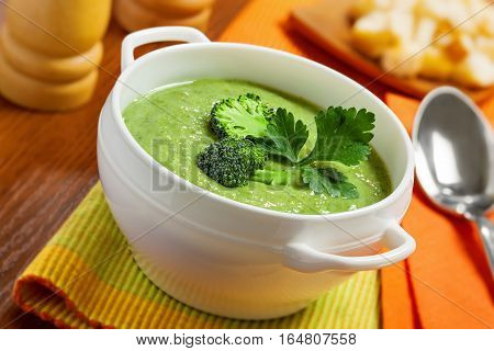 Delicious broccoli cream soup on a table. Traditional healthy food.
