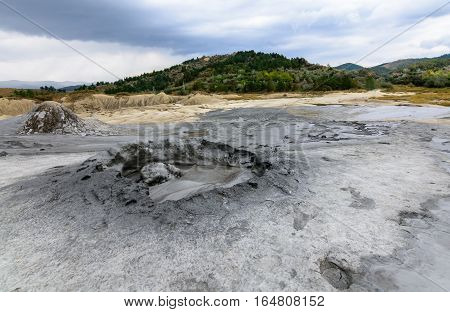 Horizontal View With Muddy Volcano Closeup. Natural Park With Muddy Volcanoes, Dramatic Landscape, U
