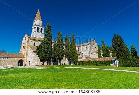 Aquileia - April 2016 Italy: Ancient Roman city of Aquileia, view on Basilica di Santa Maria Assunta