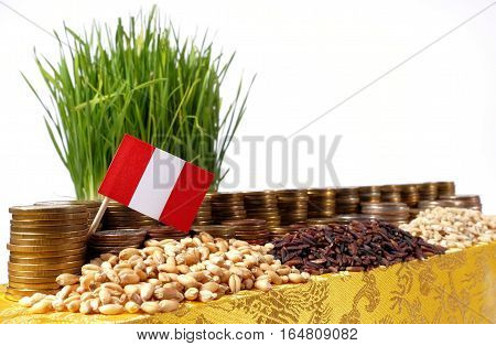 Peru Flag Waving With Stack Of Money Coins And Piles Of Wheat And Rice Seeds